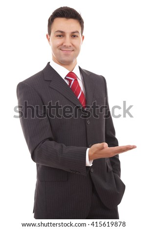 Happy businessman with arm out in a welcoming gesture isolated on a white background