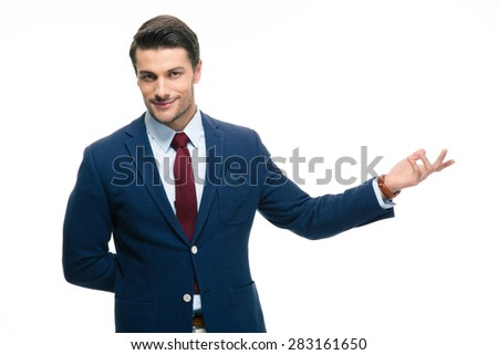 Happy businessman with arm out in a welcoming gesture isolated on a white background. Looking at camera - stock photo