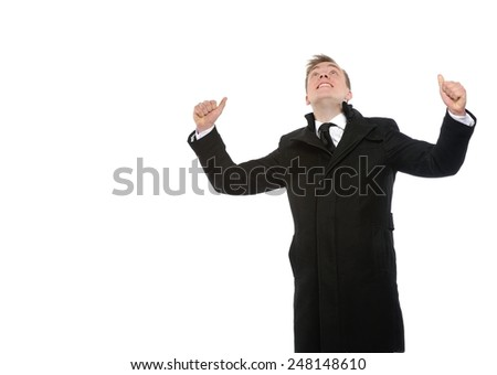 Happy businessman with arms up. Success context. Copy space on the left is for your text.  Isolated over white background.