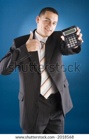 happy businessman with calculator in his hand (blue background) - stock photo