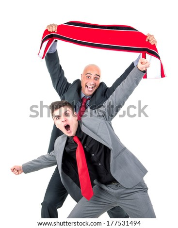 Happy businessman with football scarf celebrating a victory isolated in white - stock photo