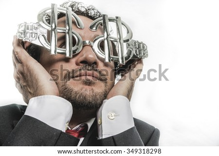 happy businessman with funny face and glasses-shaped silver dollar - stock photo