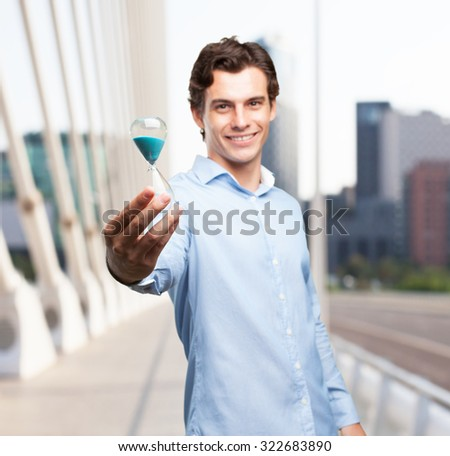 happy businessman with sand timer - stock photo
