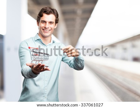 happy businessman with shopping cart