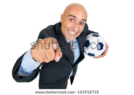 Happy businessman with soccer ball isolated in white - stock photo