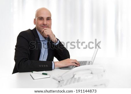 Happy businessman working at the office