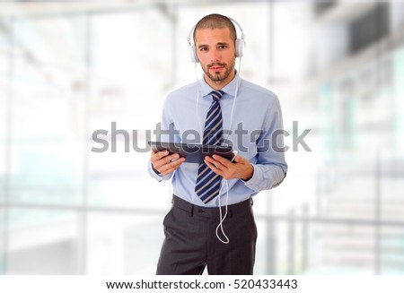 happy businessman working with a tablet pc, at the office