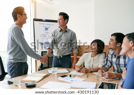 Happy businessmen shaking hands after successful meeting - stock photo