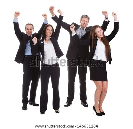 Happy Businesspeople Jumping In Joy Over White Background - stock photo