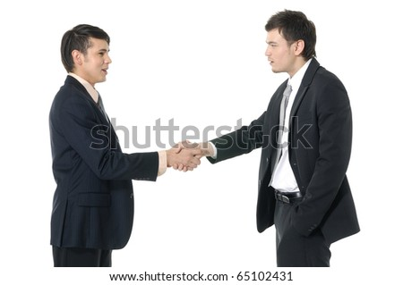 Happy businesspeople shaking hands, finishing up a meeting. - stock photo