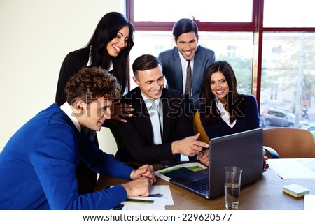 Happy businesspeople working in the office together