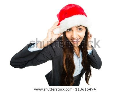 Happy businesswoman celebrating christmas wearing santa hat isolated on white background - stock photo