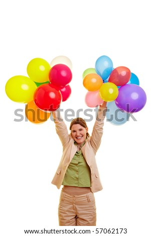Happy businesswoman celebrating with many colorful balloons