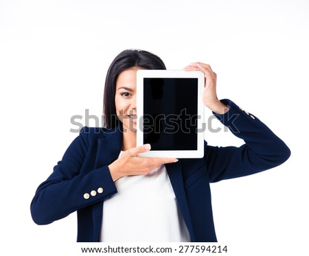Happy businesswoman covering her eye with tablet computer over white background. Looking at camera - stock photo