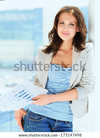 Happy businesswoman holding a paper. - stock photo