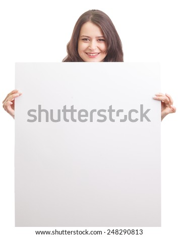Happy businesswoman holding a white banner and smiling