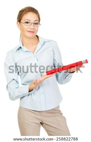 Happy businesswoman holding big pencil. - stock photo