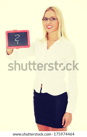 Happy businesswoman holding black board with question mark.