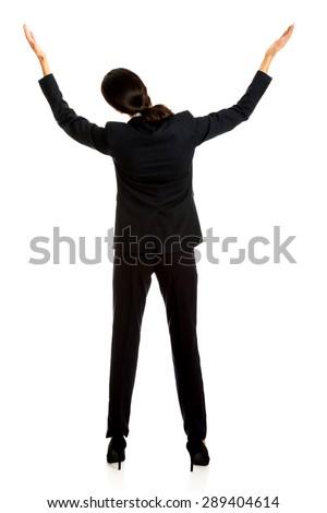 Happy businesswoman holding copyspace high. - stock photo