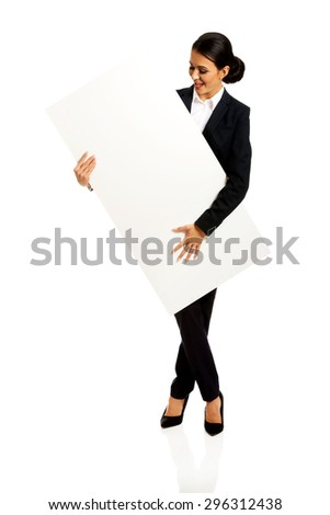 Happy businesswoman holding empty banner.