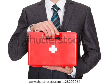 Happy Businesswoman Holding First Aid Box. Isolated On White - stock photo