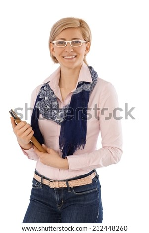 Happy businesswoman holding folder, smiling, looking at camera. - stock photo