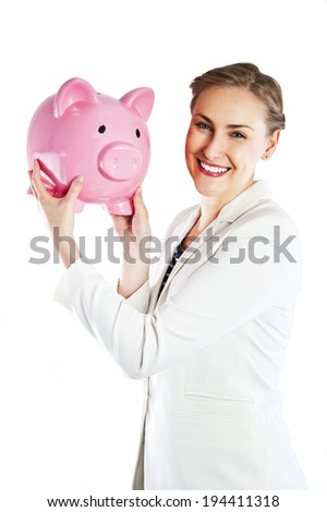 Happy businesswoman holding piggy bank against white background