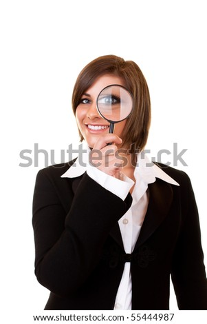 happy businesswoman looking through a magnifying glass