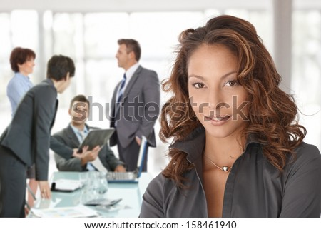 Happy businesswoman on business meeting at office, smiling. - stock photo