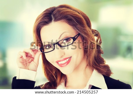 Happy businesswoman portrait, isolated on white