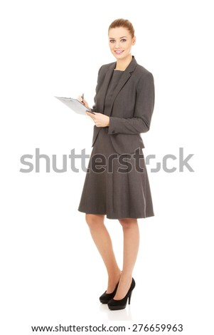 Happy businesswoman reading her notes.