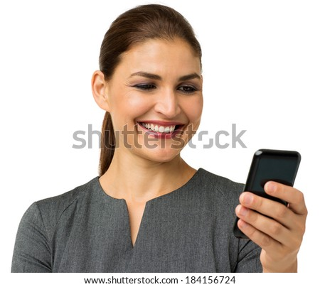 Happy businesswoman reading text message on smart phone isolated over white background. Horizontal shot.