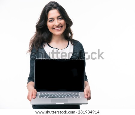 Happy businesswoman showing blank laptop screen isolated on a white background - stock photo
