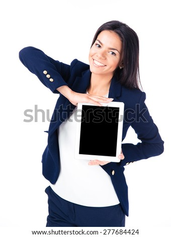 Happy businesswoman showing tablet computer screen isolated on a white background. Looking at camera - stock photo