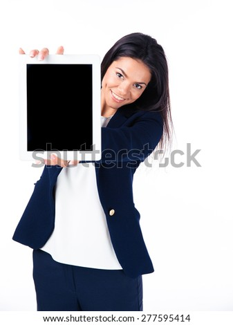 Happy businesswoman showing tablet computer screen over white background. Looking at camera - stock photo