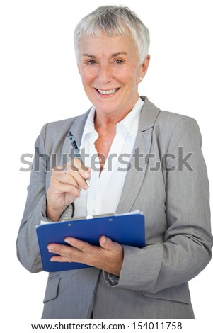 Happy businesswoman using her clipboard on white background - stock photo