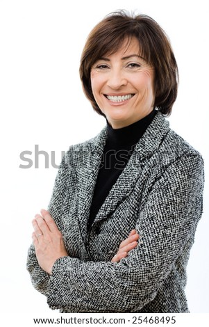 Happy businesswoman wearing grey suit standing with crossed arms, laughing. Isolated on white background. - stock photo