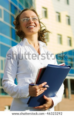 Happy businesswoman with a folder.