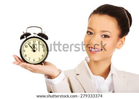 Happy businesswoman with alarm clock. - stock photo