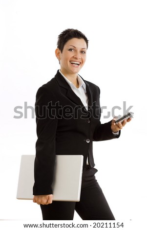 Happy businesswoman with mobile phone and laptop computer, smiling, isolated on white. - stock photo