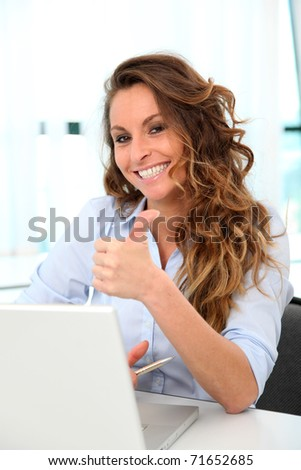 Happy businesswoman with positive attitude - stock photo