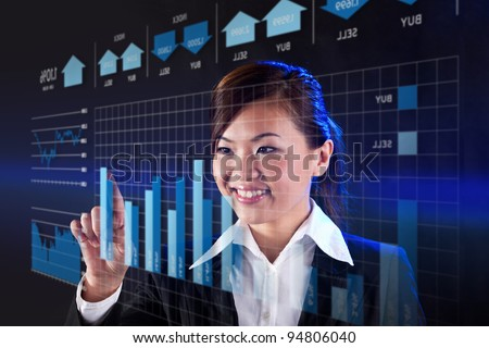 Happy Businesswoman working on a virtual digital Touchscreen. - stock photo