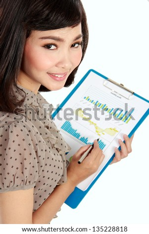 happy businesswoman working with corporate annual report - stock photo