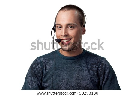 Happy call center worker smiling whilst talking to a customer - stock photo