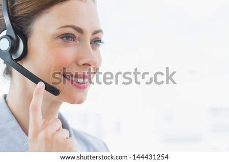 Happy call centre agent smiling wearing headset
