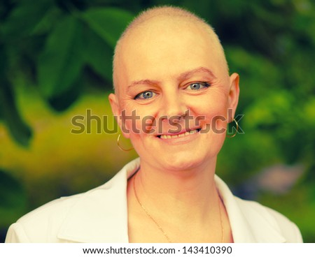 Happy cancer survivor after successful chemotherapy. - stock photo