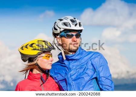 Happy carefree mountain bike couple portrait - stock photo