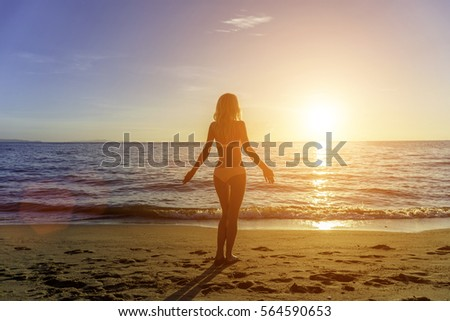 Happy Carefree Woman on the Beach