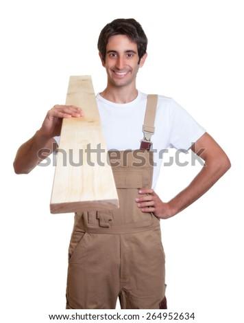 Happy carpenter with wooden beam - stock photo