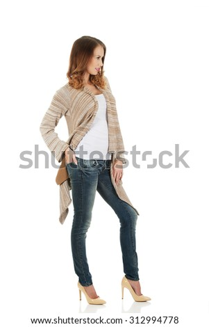 Happy casual confident woman standing. - stock photo
